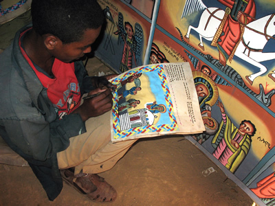 Aleqa Adisalem Gebremedhin painting a commission on parchment