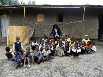 Almaz and some of the orphans outside the grade 3 classroom in Dukem