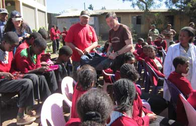 Handing out pencils and pencil cases - Dean Miles and Ian Bell