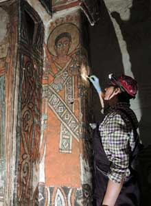 Cleaning the wall paintings of Bahera